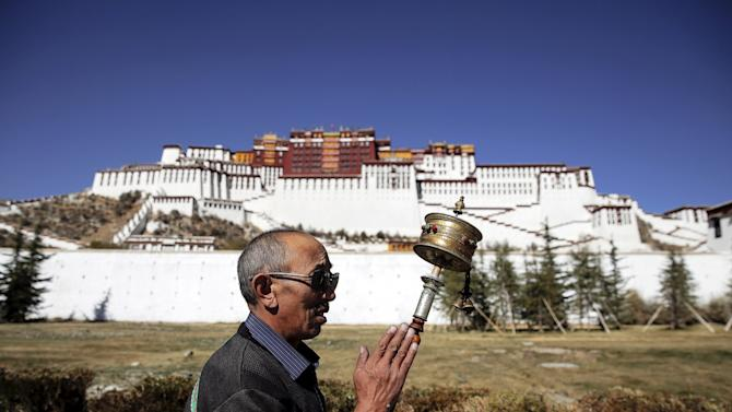 """A look at daily life in the Tibet Autonomous Region China this year is marking 50 years since the founding of what it calls the Tibet Autonomous Region. Beijing says it """"peacefully liberated"""" Tibet in 1950 and that its rule has brought prosperity and equality to a once-backward region. However, rights groups and exiles say China governs with an iron fist and represses Tibet's Buddhist people, which leads to periodic outbreaks of violence and anti-Chinese protests. China blames exiled Tibetan spiritual leader the Dalai Lama for unrest in Tibetan parts of the country, including a wave of self-immolations. The Dalai Lama fled to India in 1959 after a failed uprising against Chinese rule. The Dalai Lama denies Chinese charges he wants Tibetan independence or that he promotes violence, saying only that he wants genuine autonomy for Tibet. (Reuters) Photography by Damir Sagolj/Reuters   See more images from Tibet and our   other slideshows   on Yahoo News!"""