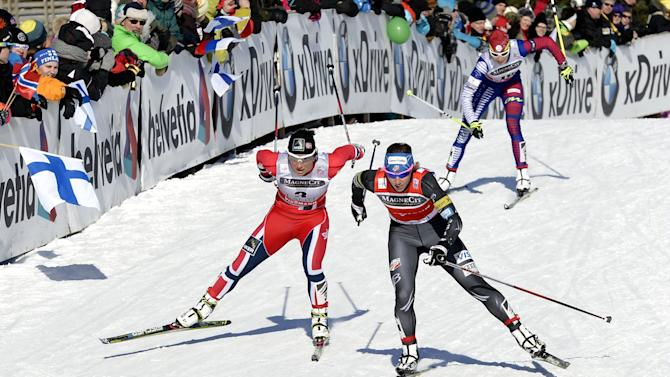 U.S. Kikkan Randall, front right, leads Norway's Marit Bjorgen in the ladies World Cup sprint event at the Lahti Ski Games on Saturday, March 9, 2013.  Slovakia's Alena Prochazkova in background came third. (AP Photo Lehtikuva, Heikki Saukkomaa) FINLAND OUT - NO SALES