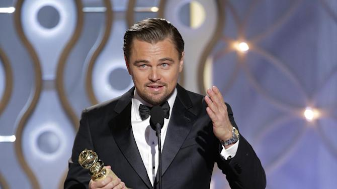 """This image released by NBC shows Leonardo DiCaprio accepting the award for best actor in a motion picture comedy for his role in """"The Wolf of Wall Street"""" during the 71st annual Golden Globe Awards at the Beverly Hilton Hotel on Sunday, Jan. 12, 2014, in Beverly Hills, Calif. (AP Photo/NBC, Paul Drinkwater)"""