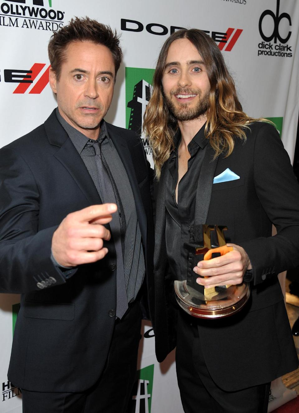 Robert Downey Jr. , left, and Jared Leto, winner of the Hollywood breakout performance award, pose backstage at the 17th Annual Hollywood Film Awards Gala at the Beverly Hilton Hotel on Monday, Oct. 21, 2013, in Beverly Hills, Calif. (Photo by John Shearer/Invision/AP)