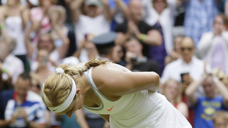 Sabine Lisicki of Germany bows to the crowd after beating Serena Williams of the United States in a Women's singles match at the All England Lawn Tennis Championships in Wimbledon, London, Monday, July 1, 2013. (AP Photo/Alastair Grant)