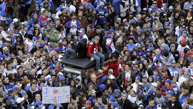 Fans line the streets in lower Manhattan waiting for the start of the New York Giants Super Bowl parade in New York, Tuesday, Feb. 7, 2012. The New York Giants are returning from their Super Bowl win to a celebration the likes that only New York can throw: a ticker-tape parade in the Canyon of Heroes on Broadway, where the city has honored stars for almost a century. (AP Photo/Seth Wenig)