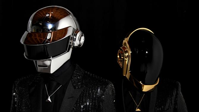 """FILE - In this April 17, 2013 file photo, Thomas Bangalter, left, and Guy-Manuel de Homem-Christo, from the music group, Daft Punk, pose for a portrait in Los Angeles. Daft Punk has set another record on Spotify. The music service said Monday, May 27, 2013, that the electronic duo's new album, """"Random Access Memories,"""" had biggest number of streams in its first week in the United States. Spotify wouldn't release the number of streams, but Daft Punk beat the 8 million streams Mumford & Sons set with """"Babel"""" last year. (Photo by Matt Sayles/Invision/AP, File)"""