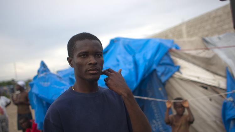 Benjamin Osner 24, stands outside his tent at a camp for people displaced by the 2010 earthquake after the passing of Tropical Storm Isaac in Port-au-Prince, Haiti, Monday Aug. 27, 2012. Ousner usually worries about supporting his common-law wife and five children. But on the eve of Tropical Storm Isaac's passage across his battered homeland, he was just worried about keeping them alive. (AP Photo/Dieu Nalio Chery)