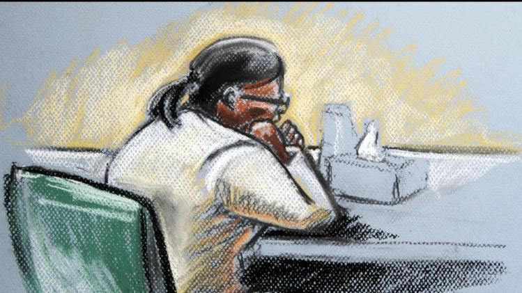 In this artists rendering, Beatrice Munyenyez is seen in Federal Court during opening arguments Thursday, Feb. 23, 2012 in Concord, N.H. Federal prosecutors say Munyenyezi lied on applications to enter the United States in 1995 and obtain citizenship in 2003. They say she ordered the rapes and murders of Tutsis in Butare during the 3-month genocide that killed about 800,000 people.  (AP Photo/Matt Sell)
