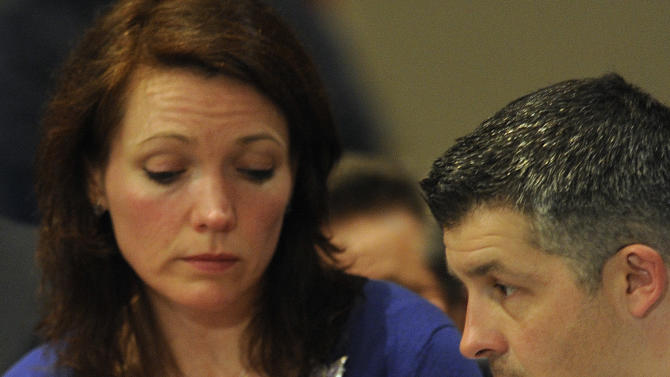 Nicole and Ian Hockley, parents of Sandy Hook School shooting victim Dylan, listen during a hearing of a legislative task force on gun violence and children's safety at Newtown High School in Newtown, Conn., Wednesday, Jan. 30, 2013. Connecticut lawmakers are in Newtown for the hearing, where those invited to give testimony include first responders and families with children enrolled at Sandy Hook Elementary. (AP Photo/Jessica Hill)