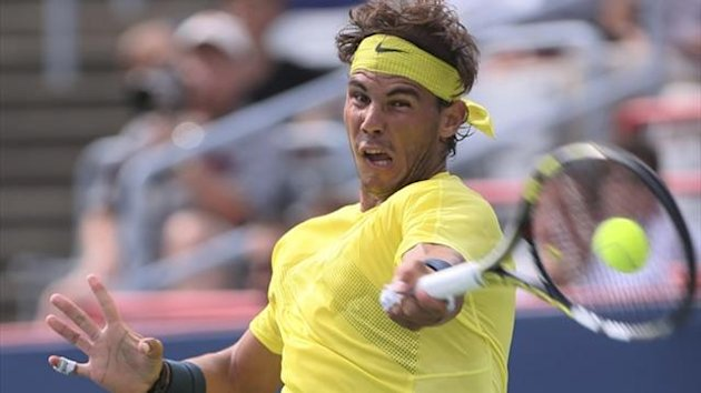 Rafael Nadal of Spain hits a return to Canada's Jesse Levine at the Rogers Cup (Reuters)