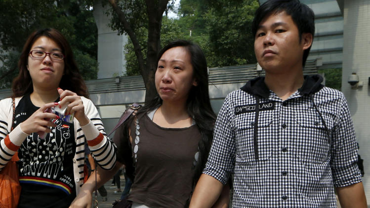 Relatives of victims who were killed in a ferry collision, leave a public mortuary in Hong Kong Tuesday, Oct. 2, 2012. A boat packed with revelers on a long holiday weekend collided with a ferry and sank off Hong Kong, killing at least 36 people and injuring dozens, authorities said. (AP Photo/Kin Cheung)