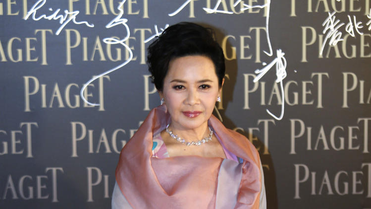 Hong Kong actress Deanie Ip poses on the red carpet of the 32nd Hong Kong Film Awards in Hong Kong  Saturday, April 13, 2013. (AP Photo/Vincent Yu)