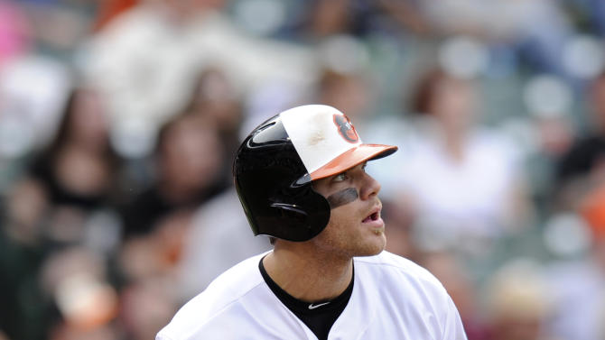 Baltimore Orioles' Chris Davis watches his two-run home run during the eighth inning of a baseball game against the Colorado Rockies, Sunday, Aug. 18, 2013, in Baltimore. The Orioles won 7-2. (AP Photo/Nick Wass)