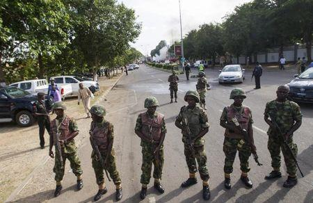 Nigeria military says still in Boko Haram stronghold despite mines