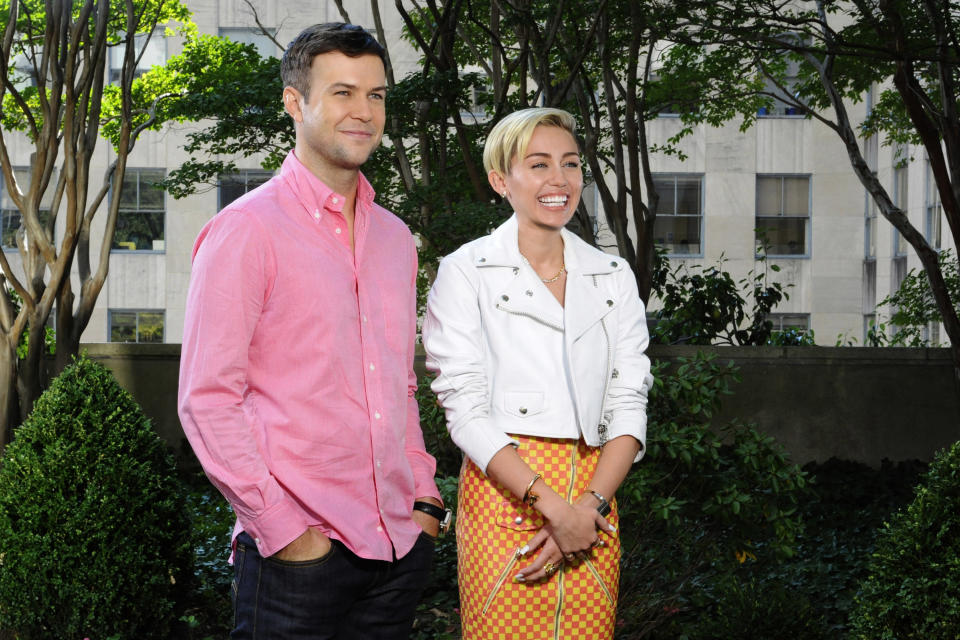 "This Oct. 1, 2013 photo released by NBC shows cast member Taran Killam, left, and actress-singer Miley Cyrus during a promo for the upcoming ""Saturday Night Live,"" in New York. Cyrus will host and perform on the late night sketch comedy series on Oct. 5. (AP Photo/NBC, Dana Edelson)"