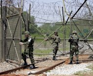 South Korean soldiers open a gate to for a train to pass close to the border with North Korea. South Korean President Lee Myung-Bak has scolded his military for negligence after a North Korean soldier defector travelled unchecked across one of the world&#39;s most fortified borders
