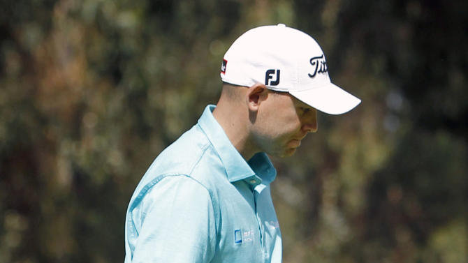 Bill Haas reacts after making par on the 12th hole in the third round of the Northern Trust Open golf tournament at Riviera Country Club in the Pacific Palisades area of Los Angeles, Saturday, Feb. 16, 2013. (AP Photo/Reed Saxon)