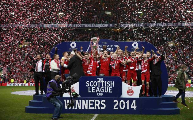 Aberdeen's Anderson holds the trophy aloft following their Scottish League Cup final soccer match against Inverness Caledonian Thistle in Glasgow