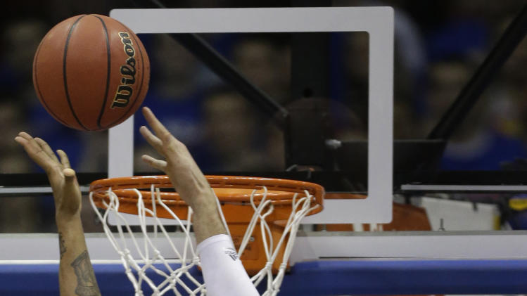 Kansas center Jeff Withey (5) blocks a shot by Kansas State guard Rodney McGruder (22) during the first half of an NCAA college basketball game in Lawrence, Kan., Monday, Feb. 11, 2013. (AP Photo/Orlin Wagner)