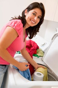Woman and washing machine