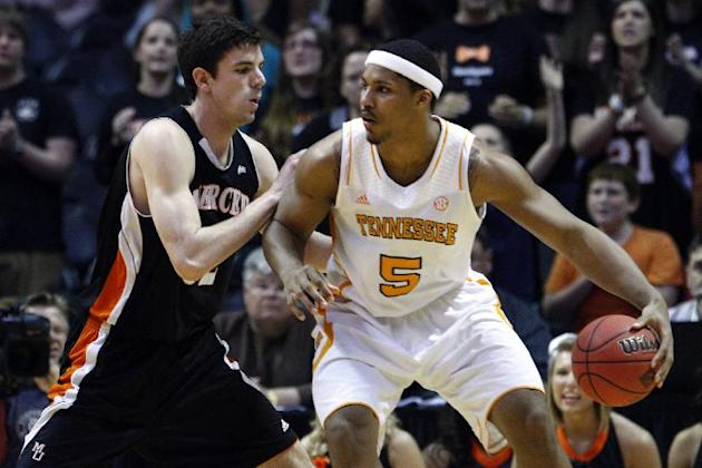 FILE -- In this March 20, 2013 file photo, Tennessee forward Jarnell Stokes (5) works against Mercer forward Daniel Coursey in the NIT college basketball tournament in Knoxville, Tenn. Stokes received