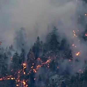 California crews scramble to fight wildfires amid drought