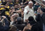 Pope Francis waves to faithful from his pope-mobile as he arrives for his weekly general audience in St. Peter's Square at the Vatican, Wednesday, Jan. 22, 2014. (AP Photo/Alessandra Tarantino)