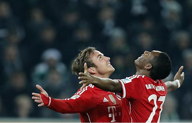 Bayern's Mario Goetze, left, and Bayern's David Alaba of Austria celebrate after scoring during the German first division Bundesliga soccer match between VfL Borussia Moenchengladbach and Baye