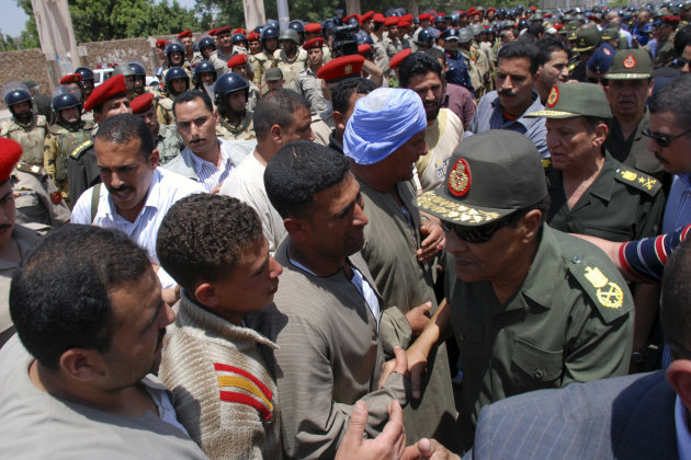 Field Marshal Hussein Tantawi, right, the head of Egypt's ruling Supreme Council of the Armed Forces (SCAF), greets mourners at a military funeral for Cpl. Samir Anwar Ismail, a commando killed in cla