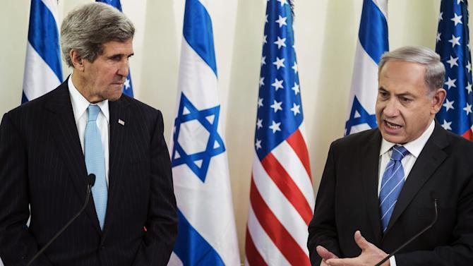 FILE - In this Jan. 2, 2014 file photo, U.S. Secretary of State John Kerry, left, listens as Israeli Prime Minister Benjamin Netanyahu makes a statement during a press conference before their talk at the prime minister's office in Jerusalem. Tuesday, April 29, 2014, was to have been the day to seal a deal on a Palestinian state alongside Israel. Instead, it became another missed deadline in two decades of negotiating failures. The gaps between Israeli and Palestinian positions remain vast after nine months of talks launched by Secretary of State John Kerry. He hasn't given up, but there's a sense the U.S. may have to change its traditional approach to brokering talks. Israeli Prime Minister Benjamin Netanyahu and Palestinian President Mahmoud Abbas now face risky paths that could lead to a new conflagration. Here's a look at what might happen next. (AP Photo/Brendan Smialowski, Pool, File)