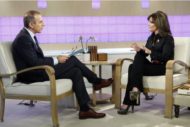 """Today"" show co-host Matt Lauer and guest co-host, Sarah Palin, talk on the show's set in New York on Tuesday, April 3, 2012. Palin was the much-hyped guest co-host on NBC's ""Today,"" going head-to-hea"