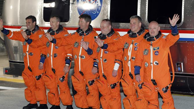 Space Shuttle Endeavour crew from right to left: commander Mark Kelly, pilot Greg H. Johnson, mission specialist Mike Fincke, European Space Agency astronaut, Roberto Vittori, mission specialist Drew Feustel and Greg Chamitoff, leave the operations and check-out building at the Kennedy Space Center at Cape Canaveral, Fla. Monday May 16, 2011. Space Shuttle Endeavour and a six member crew will launch on a final mission to the international space station. (AP Photo/Terry Renna)
