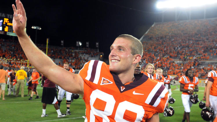 Virginia Tech place kicker Cody Journell (89) waves after making a 17-yard field goal in overtime to win an NCAA college football game against Georgia Tech, Monday, Sept. 3, 2012, in Blacksburg, Va. Virginia Tech won 20-17. (AP Photo/Don Petersen)