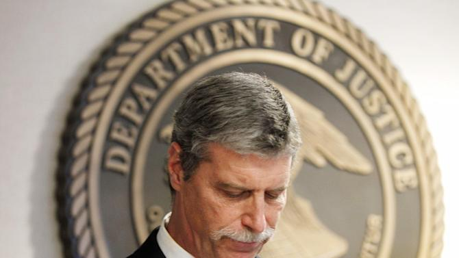 Jim Letten, U.S. Attorney for the Eastern District, announces his resignation during a news conference in New Orleans, Thursday, Dec. 6, 2012.  Letten said his resignation is effective Dec. 11 and that he plans to stay on with the department briefly to help with the transition in leadership. (AP Photo/Gerald Herbert)