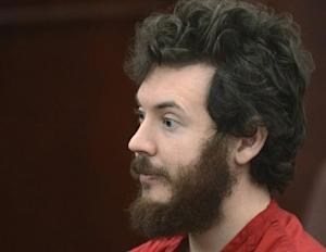 Accused Aurora theater gunman James Holmes listens during his arraignment in Centennial
