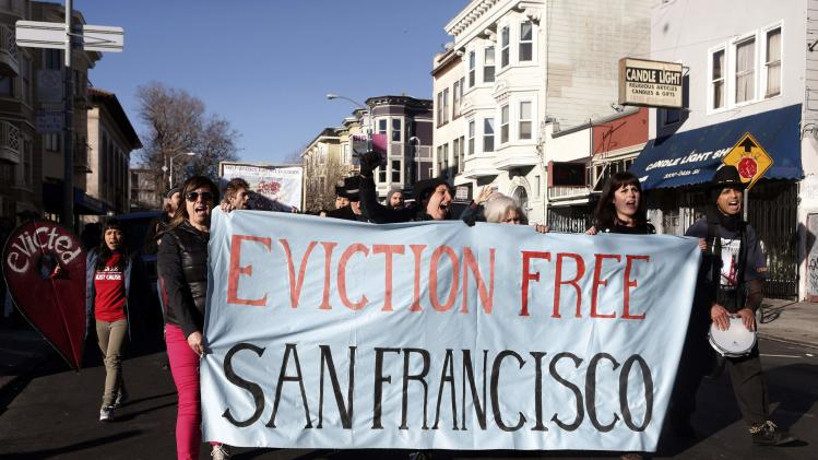 Demonstrators march during a protest against rising costs of living in San Francisco