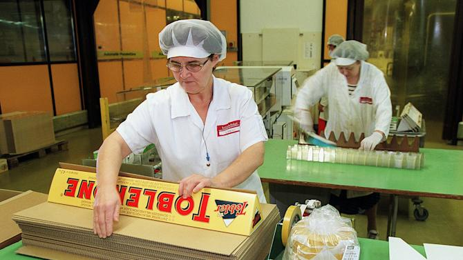 "FILE - In this Nov. 26, 1999 file photo, employees package large Toblerone chocolate bars at the Kraft Jacobs Suchard AG factory in Bern, Switzerland. A study published in the New England Journal of Medicine on Wednesday, Oct. 10, 2012 ties chocolate consumption to the number of Nobel Prize winners a country has and suggests it's a sign that the sweet treat can boost brain power. It was published online as a ""note"" rather than a rigorous, peer-reviewed study. (AP Photo/Keystone, Martin Ruetschi)"