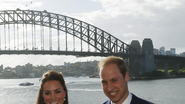 Britain's Prince William and his wife Catherine, Duchess of Cambridge, pose in front of the Sydney Harbour Bridge