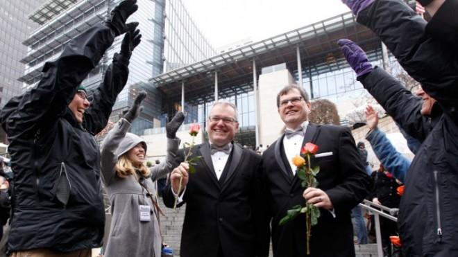 Newlyweds walk past cheering well-wishers after getting married in Seattle: 53 percent of Americans approve of same-sex marriage.