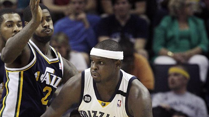 Memphis Grizzlies' Zach Randolph (50) drives around Utah Jazz's Marvin Williams (2) during the second half of an NBA basketball game in Memphis, Tenn., Wednesday, April 17, 2013. Randolph scored 25 points during the Grizzlies 86-70 victory over the Jazz. (AP Photo/Danny Johnston)