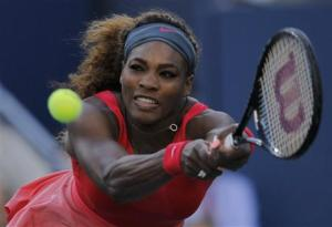 Serena Williams of the U.S. hits a return to Li Na of China at the U.S. Open tennis championships in New York