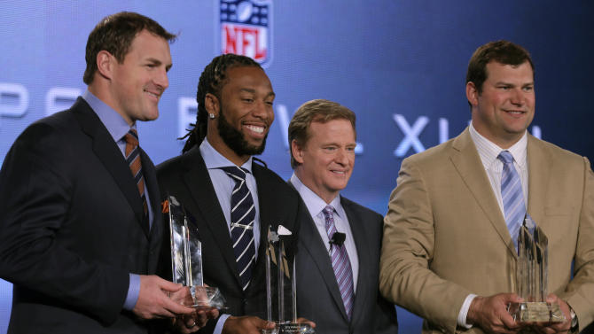 NFL Commissioner Roger Goodell , 2nd from the right, poses with the Walter Payton NFL Men of the Year finalists before an NFL Super Bowl XLVII football game news conference at the New Orleans Convention Center, Friday, Feb. 1, 2013. in New Orleans. They are (L-R) Jason Witten of the Dallas Cowboys, Larry Fitzgerald of the Arizona Cardinals and Joe Thomas of the Cleveland Browns. (AP Photo/Charlie Riedel)