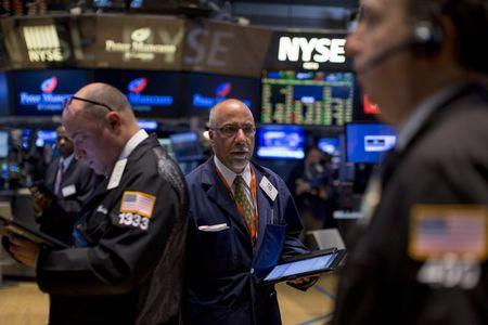 Wall St. slips as oil rally fades, earnings worries mount