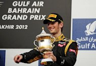 Lotus F1 Team's French driver Romain Grosjean celebrates on the podium at the Bahrain International circuit in Manama after the Bahrain Formula One Grand Prix in April 2012. Grosjean and Finnish star Kimi Raikkonen believe they must deliver faultless performances if Lotus are to challenge for a win at this weekend's Spanish Grand Prix