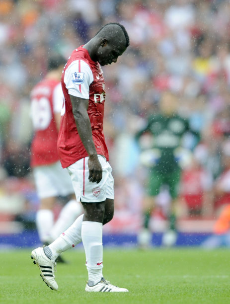 Arsenal's Emmanuel Frimpong reacts after being shown a red card by referee Martin Atkinson during their English Premier League soccer match against  Liverpool at the Emirates stadium, London, Saturday, Aug. 20, 2011. (AP Photo/Tom Hevezi)