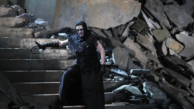 "In this photo taken Tuesday, Oct. 2, 2012, in Chicago, Elizabeth Burne as the Overseer performs during the first act of a dress rehearsal of the Lyric Opera of Chicago's new production of ""Elektra."" (AP Photo/M. Spencer Green)"