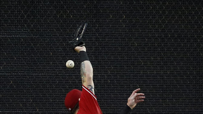 Texas Rangers left fielder Josh Hamilton is unable to reach a triple hit by Arizona Diamondbacks' David Peralta during the fifth inning of an interleague baseball game Tuesday, July 7, 2015, in Arlington, Texas. (AP Photo/Tony Gutierrez)