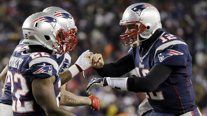 New England Patriots quarterback Tom Brady (12) congratulates running back Stevan Ridley (22) after Ridley's second rushing touchdown against the Miami Dolphins during the second quarter of an NFL football game in Foxborough, Mass., Sunday, Dec. 30, 2012. (AP Photo/Elise Amendola)