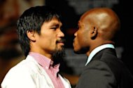 Boxers Manny Pacquiao (L) and Timothy Bradley pose during the final news conference for their bout at the MGM Grand Hotel/Casino in Las Vegas, Nevada