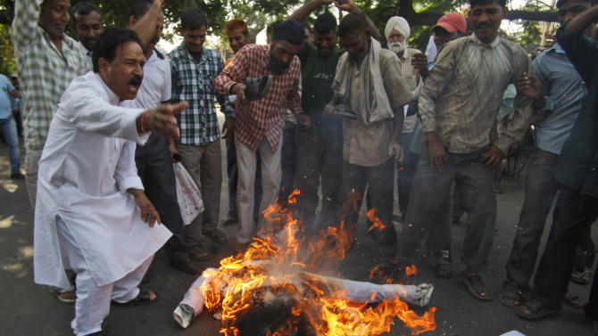 Indians shout slogans and burn an effigy representing Pakistan after Sarabjit Singh, a convicted Indian spy who was on Pakistan's death row, died from a head injury after two inmates attacked him with a brick in a Lahore jail, in Jammu, India, Thursday, May 2, 2013. Indian Prime Minister Manmohan Singh said his government would arrange to bring Singh's remains home and for his last rites to be conducted in consultation with his family. He was arrested in 1990 after bombings in Lahore and Faisalabad that killed 14 people and was convicted of spying and carrying out the bomb blasts, and the death sentence he received has been upheld in Pakistani superior courts. (AP Photo/Channi Anand)