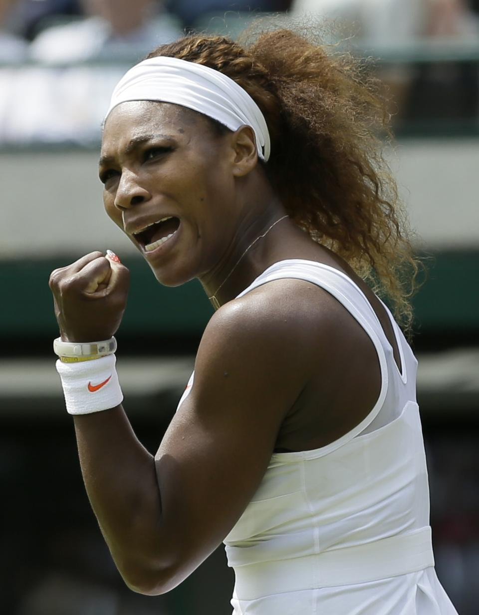 Serena Williams of the United States reacts after scoring a point against Caroline Garcia of France during their Women's second round singles match at the All England Lawn Tennis Championships in Wimbledon, London, Thursday, June 27, 2013. (AP Photo/Alastair Grant)