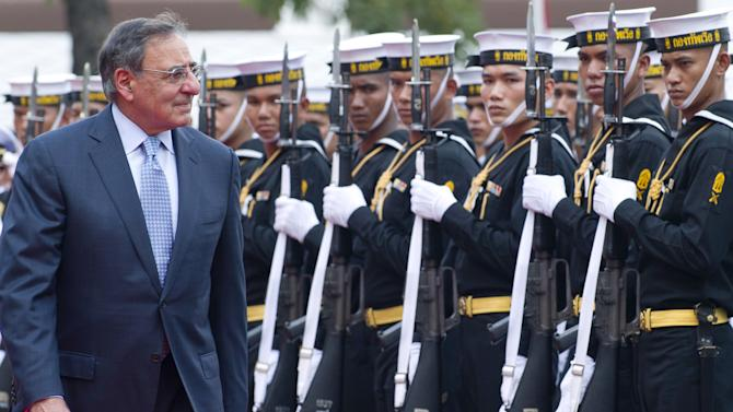 U.S. Secretary of Defense Leon Panetta reviews an honor guard during an arrival ceremony prior to meeting with Thai Minister of Defense Sukampol Suwannathat at the Ministry of Defense in Bangkok, Thailand, on Thursday, Nov. 15, 2012. (AP Photo/Saul Loeb, Pool)