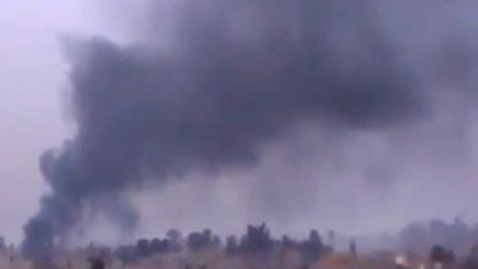 In this image taken from video obtained from the Ugarit News, which has been authenticated based on its contents and other AP reporting, Smoke rises from heavy shelling in Deir el-Zour, Syria, on Monday, Jan. 28, 2013. (AP Photo/Ugarit News via AP video)